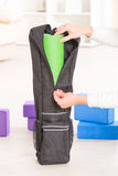 Yoga mat inside a special yoga bag Royalty Free Stock Image