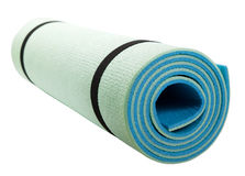 Yoga mat isolated on white Royalty Free Stock Photos