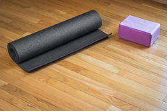 Yoga Mat and Pink Brick Stock Images