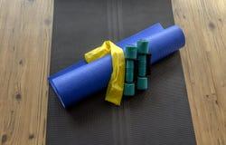 Yoga mat and resistance band Stock Photos