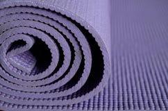 Yoga mat. Roll of purple Yoga mat Stock Images