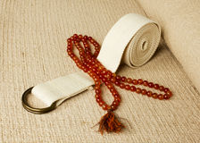 Yoga mat with rosaries and strap Stock Photo