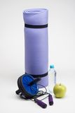 Yoga mat with skipping rope, water bottle, abs Royalty Free Stock Photo