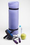 Yoga mat with skipping rope, water bottle, abs Royalty Free Stock Image
