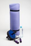 Yoga mat with skipping rope, water bottle, abs Stock Photography