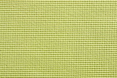 Yoga mat surface close up. Detail view of yoga mat surface and texture in green Royalty Free Stock Photo