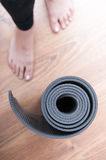 Yoga mat and woman legs Stock Images