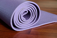 Yoga mat. On wooden background royalty free stock photos