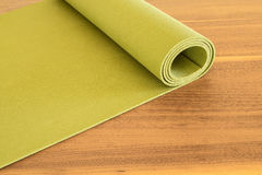 Yoga mat on a wooden background. Stock Photography