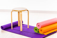 Yoga mats and chairs. Gymnastics Stock Image