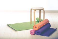 Yoga mats and chairs Stock Photo
