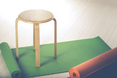 Yoga mats and chairs Stock Photos