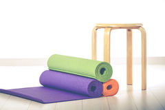 Yoga mats and chairs Royalty Free Stock Photos