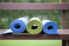 Yoga mats. Colorful yoga mats set aside Royalty Free Stock Image