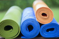 Yoga mats. Colorful yoga mats set aside on the floor Royalty Free Stock Photography