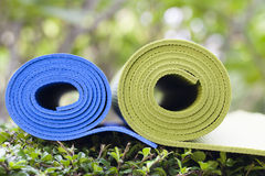 Yoga mats. The colorful yoga mats are set on grass Royalty Free Stock Photo