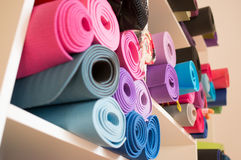 Yoga mats. Colorful yoga mats on the shelf Stock Image