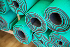 Yoga Mats. Constricted, rolled-up on a shelf in the closet Stock Photos