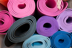 Yoga mats. Detail of colorful yoga mats Royalty Free Stock Photography