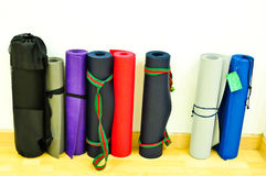 Yoga mats on floor with white background Stock Photography