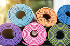 Yoga mats in the garden. Close up colorful of yoga mats in the garden Stock Images
