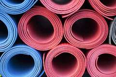 Yoga mats. A lot of colorful yoga rubber mats Stock Images