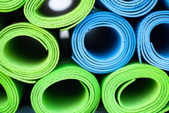Yoga mats. A lot of colorful yoga rubber mats Stock Photos