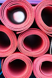 Yoga mats. A lot of colorful yoga rubber mats Stock Photo