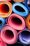 Yoga mats. A lot of colorful yoga rubber mats Royalty Free Stock Photo