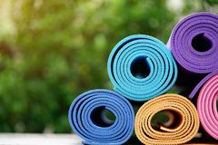 Yoga mats on table royalty free stock image
