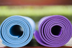 Yoga mats on the table in a garden Royalty Free Stock Image