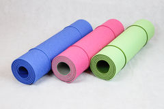 Yoga mats. Three colourful yoga mats in abstract composition Stock Photos