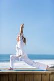Yoga matura della donna Fotografia Stock