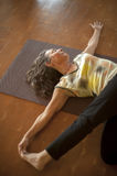 Yoga Maturity. Mature woman in a gentle yoga pose stock photography