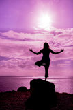 Yoga on Maui. A woman practicing yoga silhouetted on the maui coast Royalty Free Stock Photos