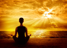 Yoga Meditating Sunrise, Woman Mindfulness Meditation on Beach stock photography