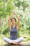 Yoga and meditation. Young woman in green forest, yoga and meditation Royalty Free Stock Photo