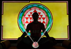 Yoga meditation. A man meditating in background of  of shree yantra Royalty Free Stock Image