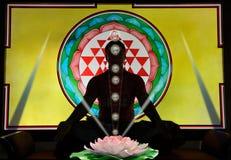Yoga and meditation. Meditation in the background of shree chakra with energy symbols Stock Photos