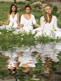 Yoga or meditation. Group women, yoga or meditation class outdoors Stock Photo