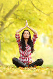 Yoga meditation in autumn Stock Photo