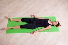 Yoga meditation class. Girl meditating during yoga class Royalty Free Stock Images
