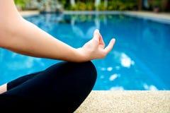Yoga Meditation hand by pool Stock Photo