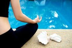 Yoga Meditation hand by pool Stock Image