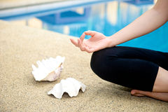 Yoga Meditation hand by pool Royalty Free Stock Photography