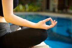 Yoga Meditation hand by pool Stock Photos