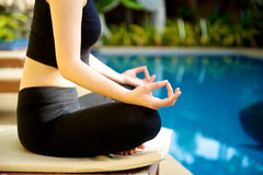 Yoga Meditation hand by pool Stock Images