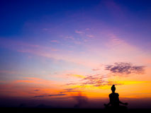 Yoga and meditation. Healthy lifestyle concept,Yoga and meditation, Silhouette of free happy woman enjoying nature on sunset stock photography