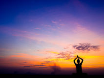 Yoga and meditation. Healthy lifestyle concept,Yoga and meditation, Silhouette of free happy woman enjoying nature on sunset royalty free stock photo