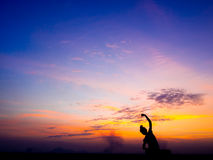 Yoga and meditation. Healthy lifestyle concept,Yoga and meditation, Silhouette of free happy woman enjoying nature on sunset royalty free stock photos